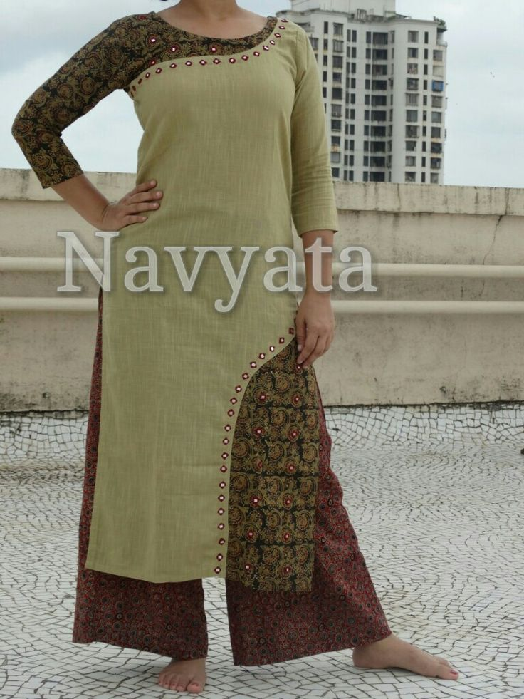 With navratri nearing, grab this designer Ajrakh kurti with a mirror work. For…