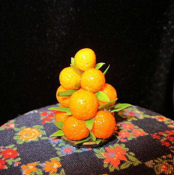 Orange Fruit Pyramid. www.teeliesfairygarden.com . . . Any single fairies out there? The gentleman fairies could use some apples and the lady fairies some orange to finally meet a special someone this year. Set them up on the fairy table for good love luck this Lunar New Year. #fairyscoop