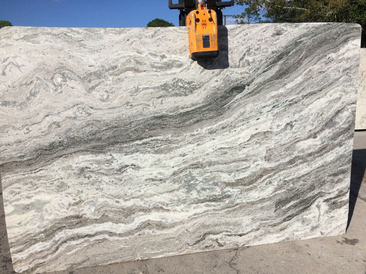 #FantasyBrown #granite is a beautiful natural stone, a perfect #granitecountertops slabs for light and dark #kitchencabinets. Nice variation in stone looks like waves of ocean with nice beige background in slab which can go with your #kitchenisland.