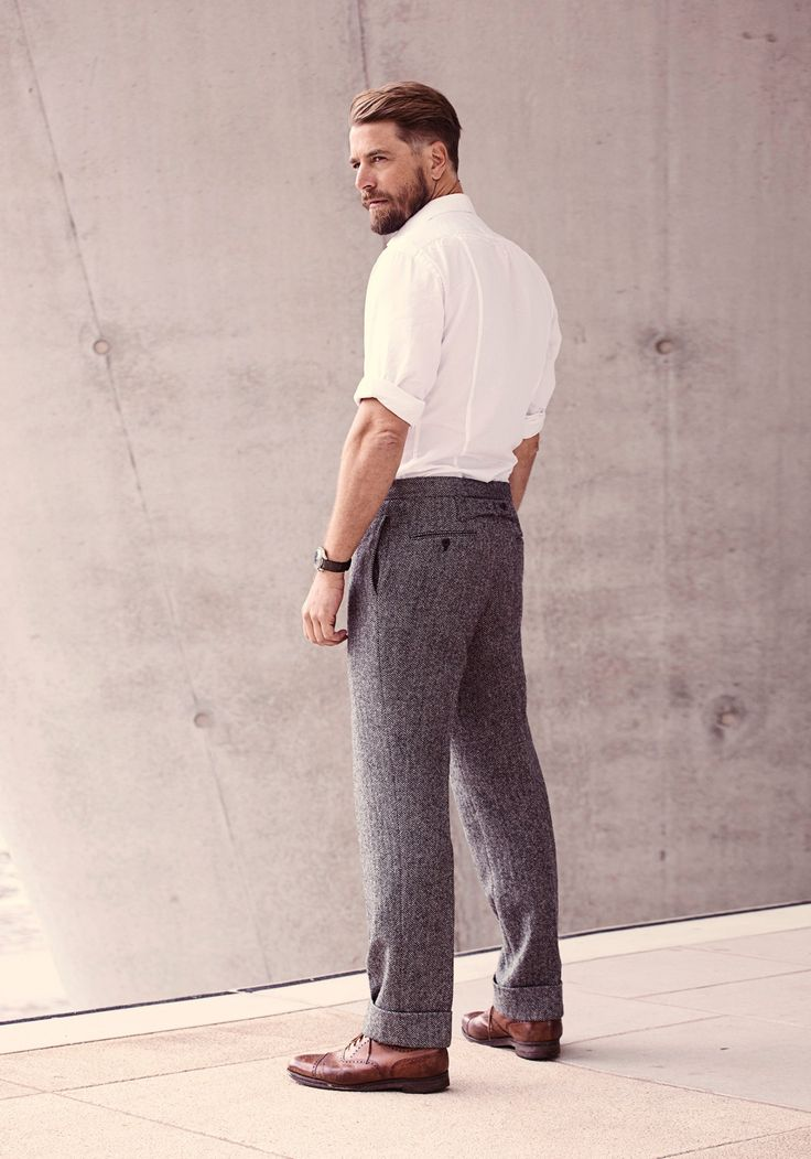 Grey flannel trousers with white shirt. (Beard and hair style is also good)