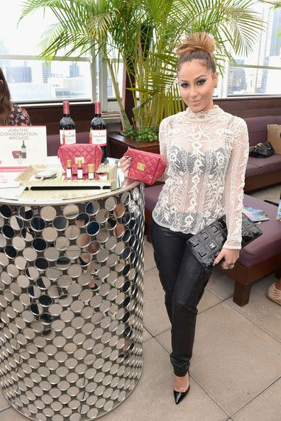 The shiny Adrienne Bailon ...  Voguish mode...   Bailon first rose to prominence as the lead singer of the all female group 3LW, along with Kiely Williams and Naturi Naughton.