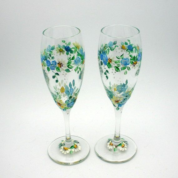 ROMANTIC GARDEN of hand painted wine glasses. Crystal champagne flutes have three painted horizontal dainty rings of blue rosebuds and
