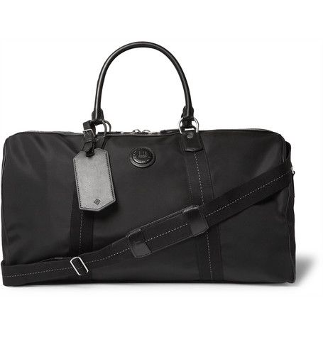 <a href='http://www.mrporter.com/mens/designers/dunhill'>Dunhill</a>'s 'Guardsman' holdall is a reliable choice for leisurely ventures and business trips alike. Made from sleek and hard-wearing canvas, this considered piece is spacious enough to carry a weekend's worth of clothes and other essentials. The leather trims provide added durability, while the internal pockets are ideal for organising smaller items. Carry yours ...
