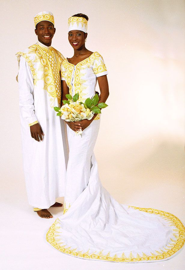 Gold embroidered African bridal gown and groom's agbada, dashiki (shirt), trousers and hat by TeKay Designs