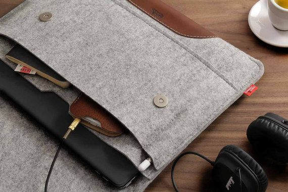 "The Hampshire for your iPad Pro12.9 - Custom made for your iPad Pro 12.9"" + Apple Smart Keyboard - High quality materials: 100% pure Merino Wool felt (Made in Germany)  Grip pad made from finest italian vegetable tanned leather - Frontpocket for your Apple pencil, smartphone, notebook etc. - Ultra thin magnatic closures  This tablet case for your Apple iPad Pro 12.9 with the Apple Smart Keyboard comes in a stylish way and also protects your tablet from scratches and bumps and fits like a…"