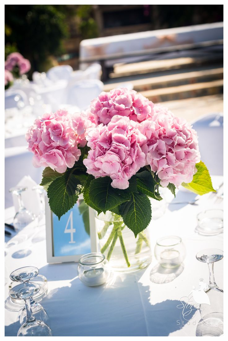 Beautiful pink wedding flowers for the perfect table setting!