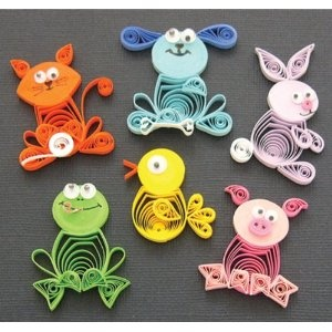 paper quilling. These would look so cute in a nursery, a crib mobile, glue to baby picture frames, good addition to book scrapping, etc...