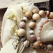 Купить или заказать Браслет 'Мечтательная' в интернет-магазине на Ярмарке Мастеров. Очень женственный и романтичный браслет. Изящный, трогательный, нежный по цвету и необычный по форме. В браслете соединено множество интересных камней и фактур: крупная деревянная бусина из дуба, розовато-лиловые кусочки жемчуга кейши неровной формы, океаническая яшма, пыльно-розовые родониты, солнечный камень персикового оттенка, желтый агат и окаменелый коралл с интересными живописными рисунками внутри.
