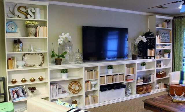 Giving IKEA billy bookcases a built in look. Love it!