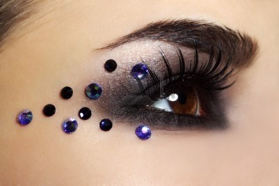 Dramatic black smokey eye shadow with an array of crystal accents.