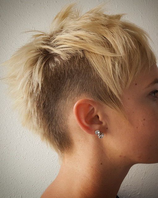 She is keeping it fierce with a lady mohawk. We love faded hair. Photo and barbering courtesy of @lion_among_wolves.