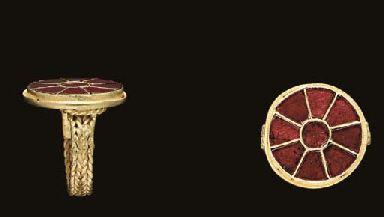 A MEROVINGIAN GOLD AND GARNET FINGER RING  CIRCA 5TH CENTURY A.D.