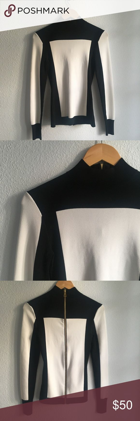 Balmain Sweater Balmain for h&m heavy knit sweater. Black and white with a large gold zipper on the back. Never worn. In new condition. Size 6 Balmain Sweaters Crew & Scoop Necks