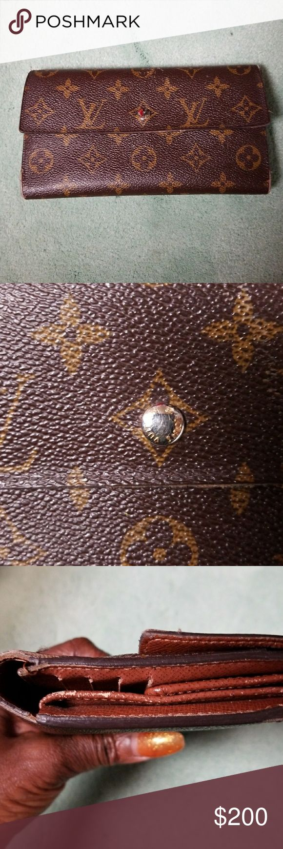 Authentic Sarah wallet Louis vuition wallet used but still has life yet,no tear just a little worn on corners,date code and snap closure works fine tv higher Louis Vuitton Bags Wallets
