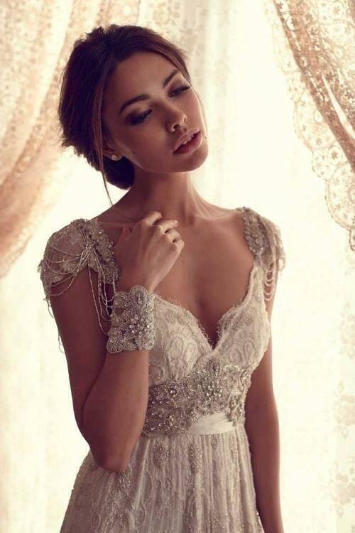 Stylish wedding gown with beaded epaulettes