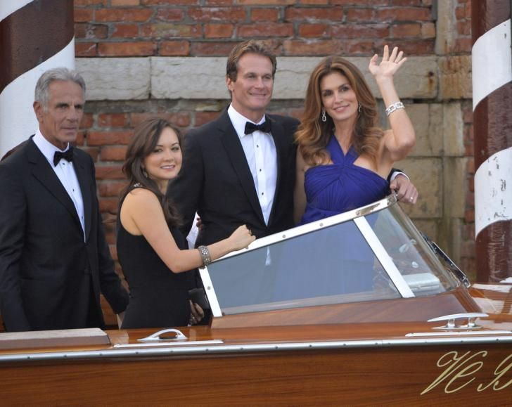 That's Amore! Happily married Rande Gerber and former supermodel Cindy Crawford arrive via boat taxi for the wedding of George Clooney and Amal Alamuddin on Sept. 27, 2014.