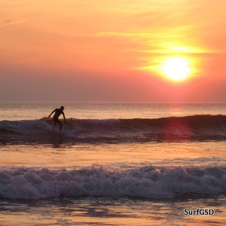 During the summer months we offer surf courses from dusk until dawn as you can see by the picture this is a sunset surf session at Rhossili bay.