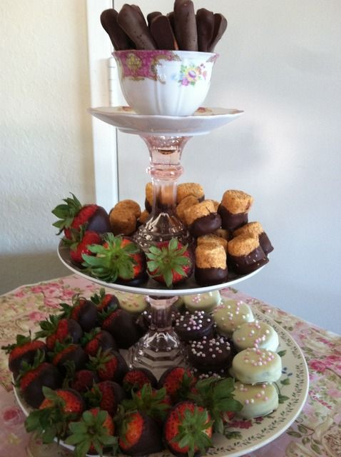 love the homemade tier (plates and candle sticks) with a tea cup and saucer at top!