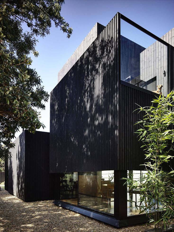 Contemporary exterior of the extension is dark and elegant