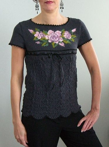Summary: Short sleeve, scoop neck pullover with intarsia floral pattern over stocking stitch yoke, with lace from bust down. Picot neck and cuff edging in Lurex Shimmer. A narrow ribbon circles the sweater at bust line, tying in front. by SusanCrowe, via Flickr