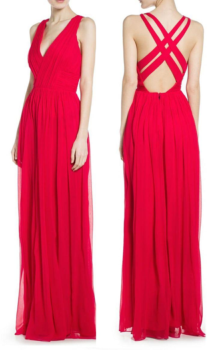 Vestido largo de seda plisada con escote de pico cruzado y tiras cruzadas en la espalda. Color Fresa. MANGO