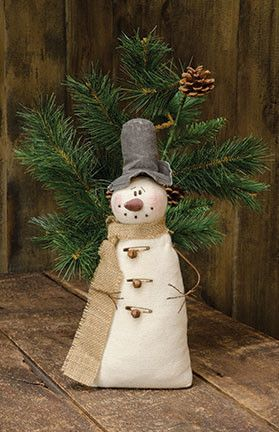 Made of soft fabric, the Vintage Snowman has wire arms and a burlap scarf with rusty bell and safety pin accents. Measures 13½inches high and 5inches wide.