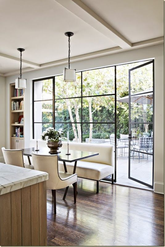 Wood floor, large warehouse style windows, neutral colours