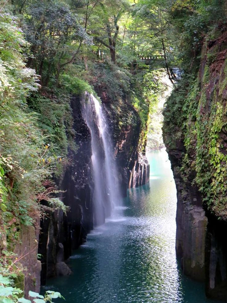 The Manai Waterfall pours over basalt cliffs in the Takachiho Gorge at Takachiho on Kyushu Island, Japan.
