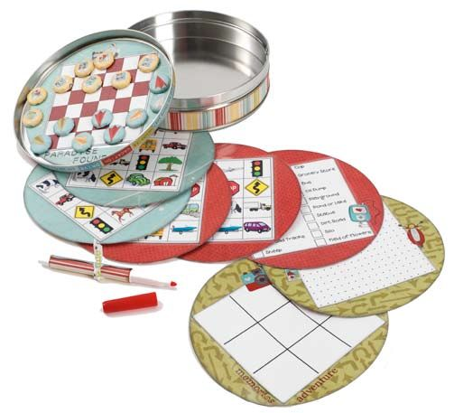 TRAVEL GAME TIN  Make your own travel game tin with scrapbook papers and homemade magnet game pieces. This travel game tin from Imaginisce works well for long car and airplane trips.