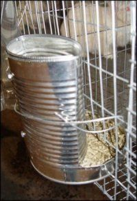 Great DIY feeder for rabbit cages. Still needs a cover if used outside to prevent rainwater entering.