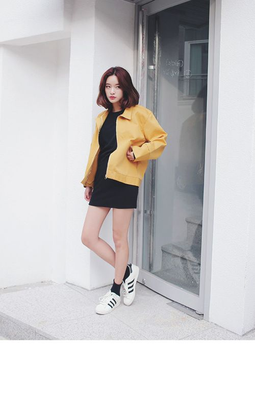 I like how her outfit is fairly simple with the plain, black, dress but her jacket sets it off with the bright pop of yellow - nice contrasting!