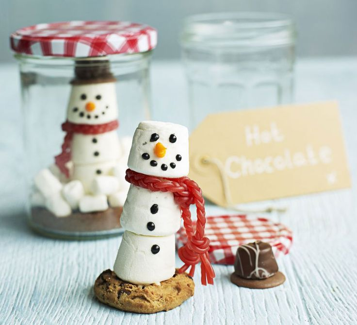 Marshmallows and strawberry laces transform into a snowman in this cute edible gift idea - a hot chocolate kit in a jam jar - perfect for kids