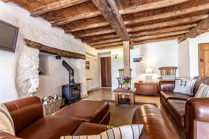 Cob Cottage - the spacious and comfortable sitting room with cosy woodburner stove.