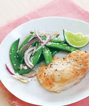 Halibut With Sugar Snap Pea Salad 1 tablespoon fresh lime juice 1 teaspoon grated fresh ginger 2 tablespoons olive oil kosher salt and black pepper 12 ounces sugar snap peas (4 cups), strings removed 1 small red onion, thinly sliced 1 tablespoon sesame seeds, toasted (optional) 4 6-ounce pieces halibut fillet 1 lime, cut into wedges