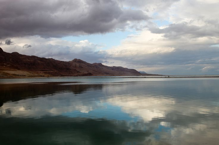 THE DEAD SEA - Between Israel and Jordan Not only is the dead sea known for its extremely saline water, the salt lake also has the lowest elevation and the lowest body of water on the surface of the earth; it lies 1300 feet (400 metres) below sea level.