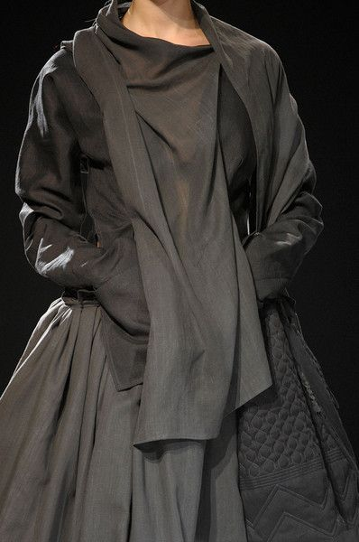 like the idea of pieces streaming down, vertically.  also the quilting (lower right), adding texture __ Yohji Yamamoto -- spring 2012