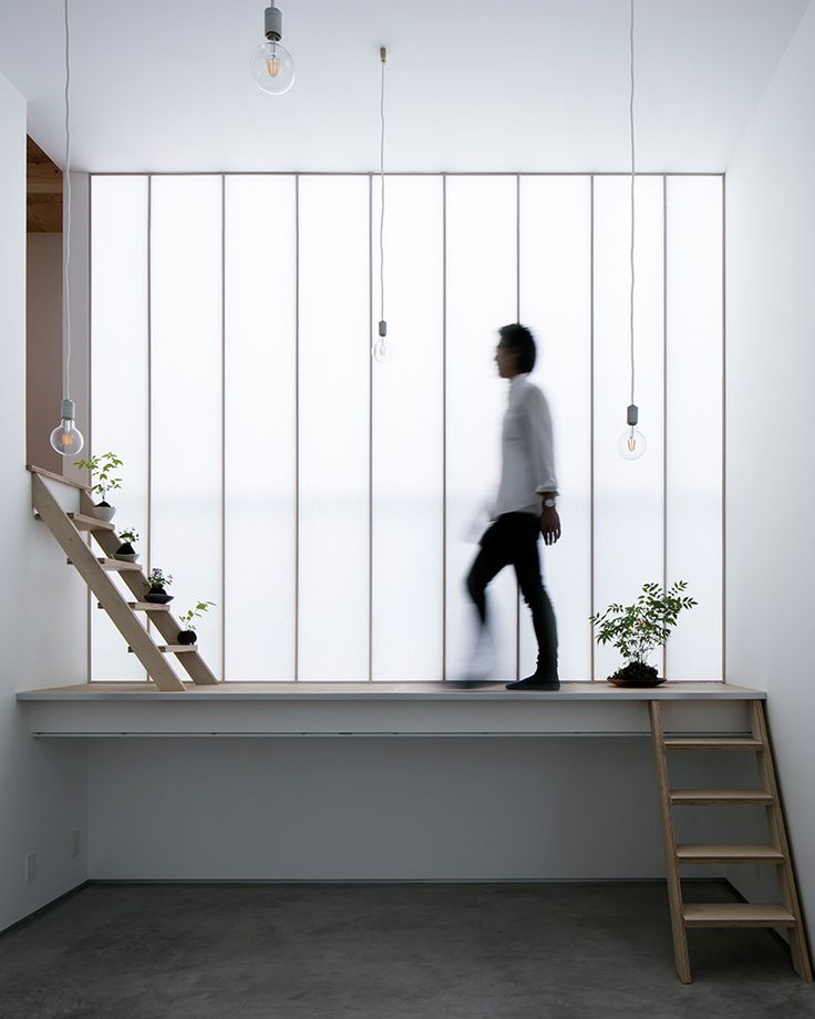 yoshiaki yamashita uses a giant shoji screen to illuminate osaka house