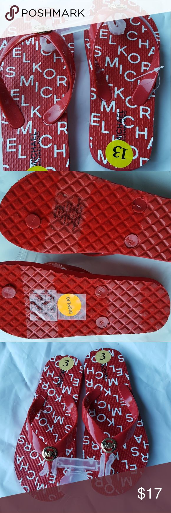 Michael Kors Jory Center Red Flip flops size 13-1 New with out tags.  This is a store display and have been tried on and shows minor signs of use of use.  Clean inside out.  Non smoking environment Michael Kors Shoes Sandals & Flip Flops