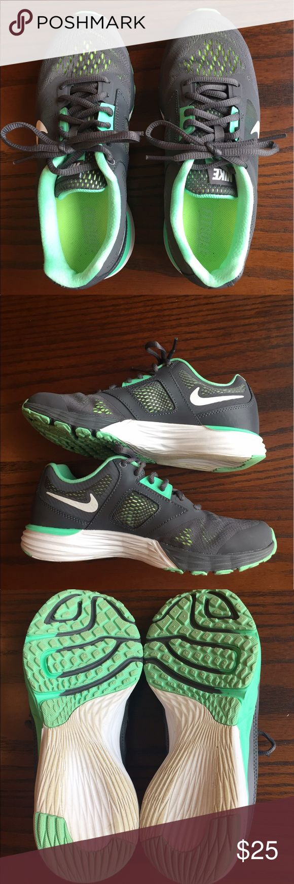 Nike Tri Fusion shoes Nike Tri Fusion shoes. Only worn twice. My feet grew after I had a baby and I can't fit into them.  Like new condition. Super cute grey with mint green accents. Nike Shoes Athletic Shoes