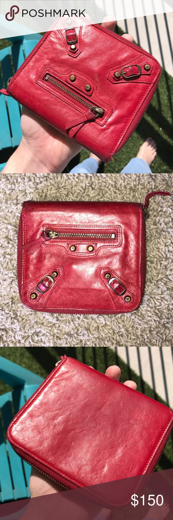Red Balenciaga Wallet! Does have signs of wear and minor scratches on the outside as well as marks on the inside pocket and card slot, all pictured. The price reflects the wear & with that being said it's still a great wallet and Balenciaga only looks better as it ages the way the Leather is. It's a great size for small purses & crossbodys has 5 card slots, one zippered pocket & large pocket for bills.   Was bought at Barneys NY but over the years I've lost the tags and dust bag so, it only…