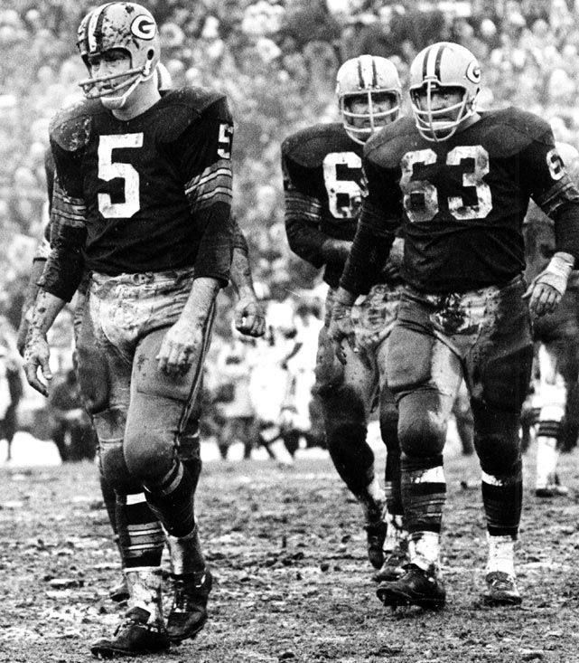 Teammates (from left) Paul Hornung, Jerry Kramer and Fred Thurston exit the field in 1965.