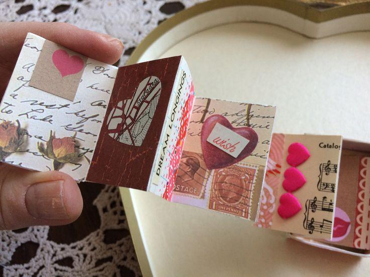 A miniature Valentine book that fits inside a matchbox. Made by Jane Corbett.
