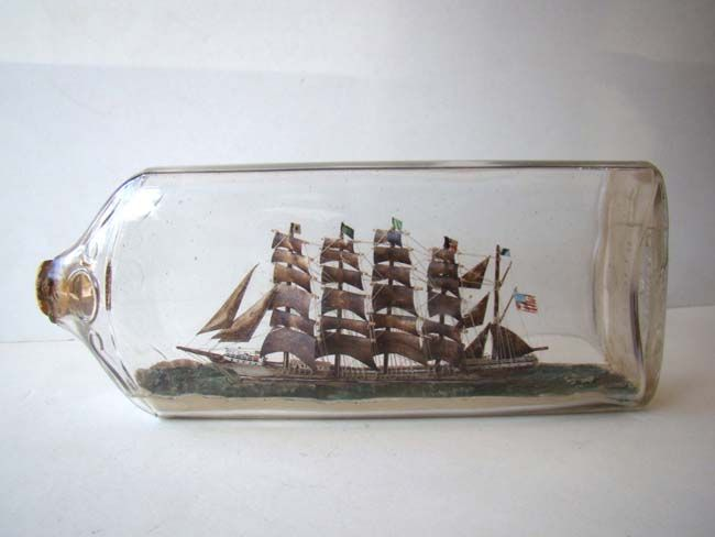 click to view larger image of A highly detailed five-masted ship in a Bottle flying the American flag circa 1900