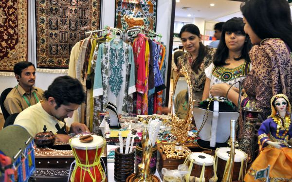 ISLAMABAD: April 17 - Visitors viewing the different stalls setup during Industrial Exhibition at Pak-China Friendship Centre Shakarparian organized by Pak-China Business Forum 2012 and COMSATS Institute of Information Technology.