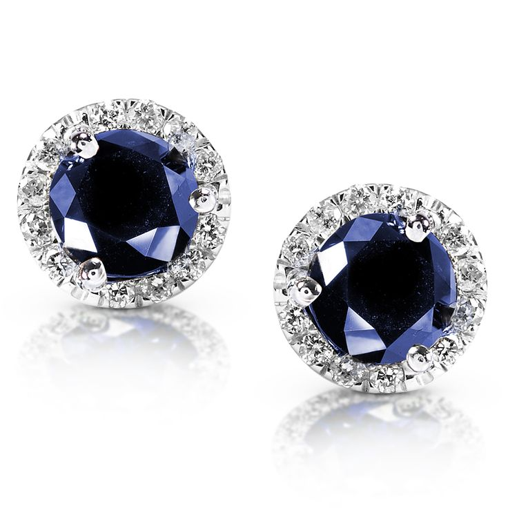 Deep blue sapphire and white diamond halo earrings in 14-karat white gold.