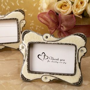 Stylish Ivory Swirl Victorian Place Card Frames (Cassiani Collection 1827) | Buy at Wedding Favors Unlimited (http://www.weddingfavorsunlimited.com/stylish_ivory_swirl_victorian_place_card_frames.html).