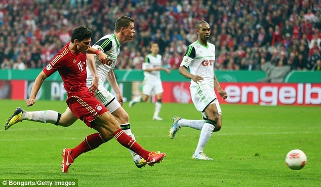 Mario Gomez scoring the third of his hat-trick for FC Bayern Munich against Wolfsburg in the 2013 DFB-Pokal semi-final at the 86 minute mark (Bongarts/Getty Images in UK Daily Mail)