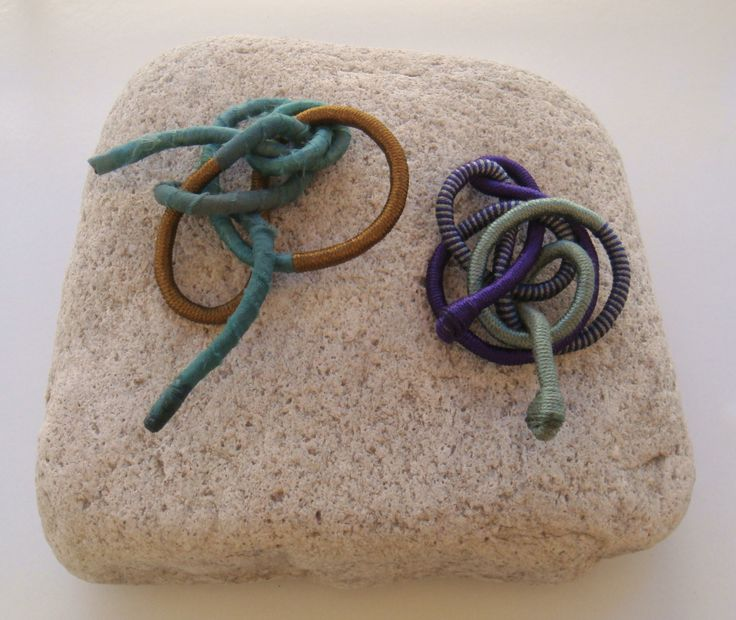 brooches with silky textile and silky yarn
