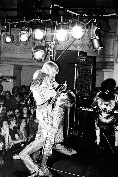 Mick Ronson and David Bowie on stage at Oxford Town Hall, 1972. Photo by Mick Rock.