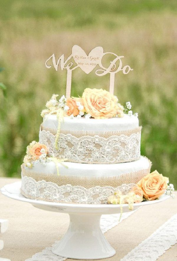 Burlap and lace wedding cake idea with 'We Do' topper from For Love Polka Dots / http://www.deerpearlflowers.com/rustic-country-burlap-wedding-cakes/